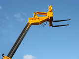 The Top of a High Lift Yellow Hydraulic Fork Lift Truck. poster