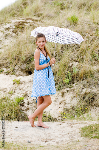 Fashion girl blue polka dress and umbrella