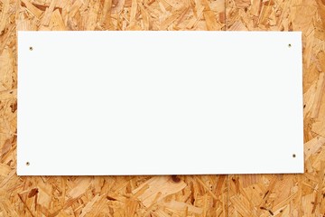 White blank sign on recycled wood board.