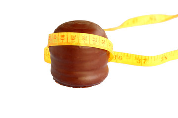 chocolate foam kiss with tape measure isolated