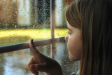 The child at a window. A rain