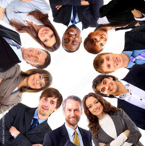 Group of business people standing in huddle,