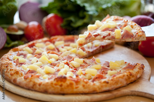 Hawaiian Pizza lifted slice