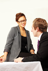 Pretty office female takes interest in male colleague