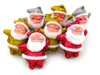 Some dolls of Santa Claus are together