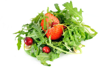 Salad with fresh rucola leaves and berries
