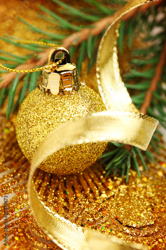 christmas balls with golden ribbon and tree