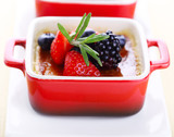 Creme brulee with fresh berries (blackberry; strawberry; blueber