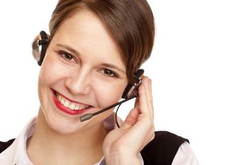 Junge schöne Frau mit headset lacht glücklich und telefoniert