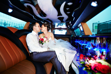 Bride and groom in wedding limo