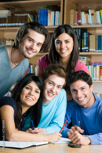 Happy students studying together