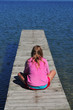 Girl Sitting on Dock