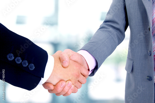 handshake isolated in office.