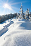 Snowdrifts on winter snow covered mountainside and sun