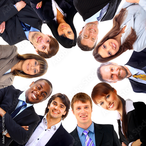 Group of business people standing in huddle, smiling,