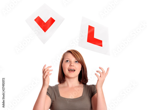 Pretty teenage girl passing her driving test