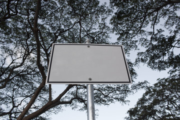 blank sign with trees above