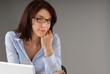 Attractive business woman contemplates the future