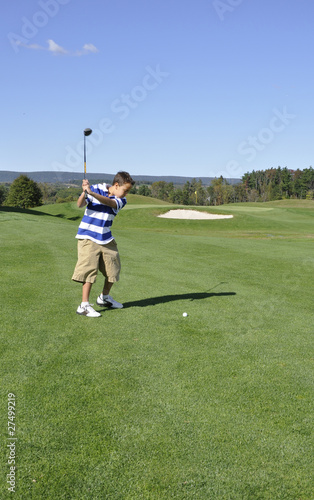young boy on golf course