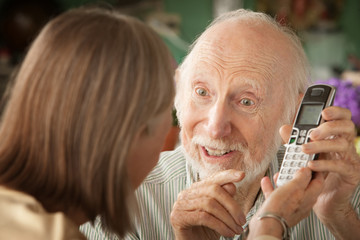 Senior couple with telephone