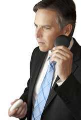 Businessman Holds Black Concept Stone to Ear