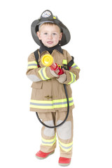 Toddler dressed as fireman ready to put out a fire