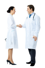 Full body portrait of two medical people handshaking, isolated