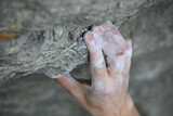 Rock climber's hand on handhold