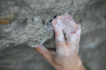 Rock climber's hand on handhold