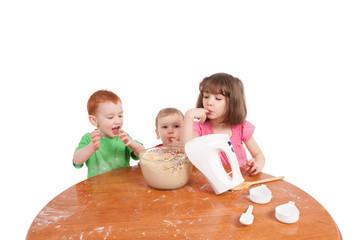 Kids tasting cake mix