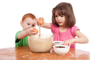 Kids baking chocolate chip cookies