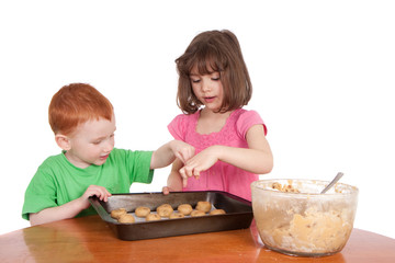 Kids counting chocolate chip cookies to bake