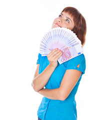 Red-haired teen-girl with money in hand