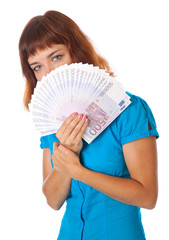 a girl is holding money in her hands