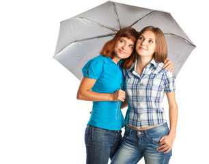 girls are standing under the umbrella