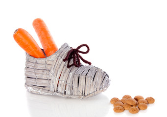 carrots in a shoe for Dutch Sinterklaas feast isolated over whit