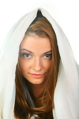 A young girl with blond hair in white hood