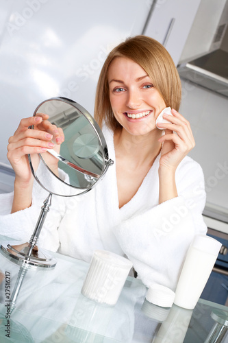 woman taking care of her face
