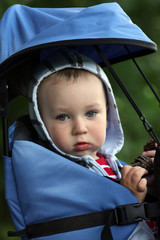 Baby boy in backpack carrier on walking tour