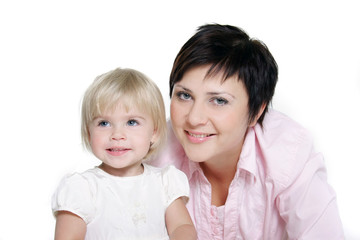 studio portrait of attractive mother and daughter over white