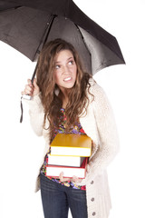 Woman with books under umbrella