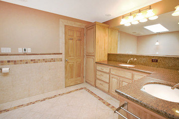 Bathroom with maple color cabinets