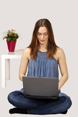 Young woman working on laptop in peaceful environment