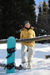 Snowboarder girl relaxing