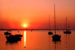 Yachts near the island on the golden sunrise over the sea