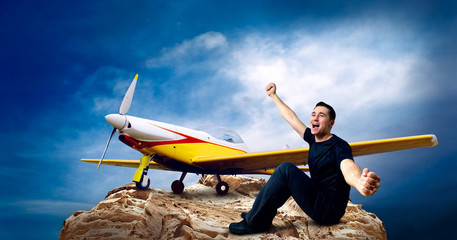 Man on the top of mountain and airplane