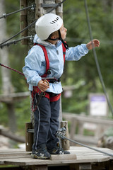 Little boy in adventure park