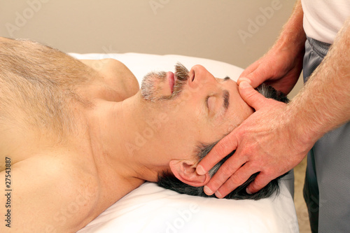 Man Massaging Male Face