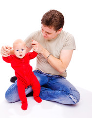 Father helping baby