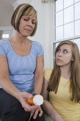 Mother showing concern about her daughter's pills